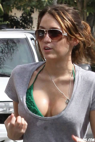 miley cyrus wallpaper 2010. Miley Cyrus iPhone Wallpaper